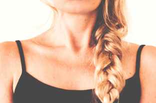 woman in black tank top with braided hair